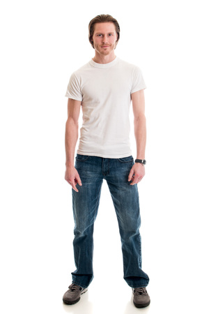 Man in jeans and white tee shirt. Studio shot over white. Banque d'images