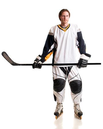 inline: Roller hockey player. Studio shot over white. Stock Photo