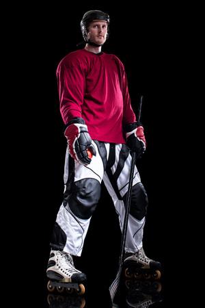 inline: Roller hockey player. Studio shot over black. Stock Photo