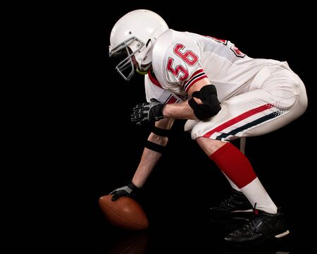 football player: American football player. Studio shot over black. Stock Photo
