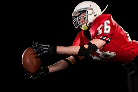 American football player. Studio shot over black. 写真素材