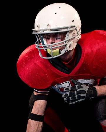 American football player. Studio shot over black. Reklamní fotografie