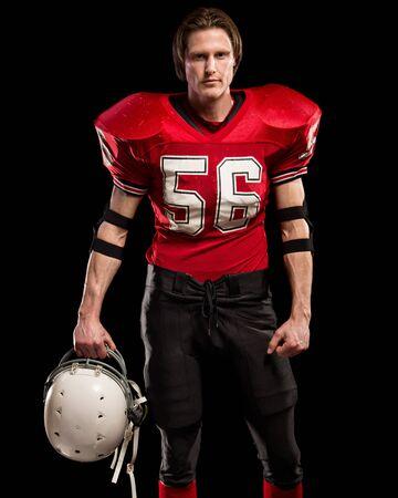jugador de futbol: jugador de fútbol americano. Foto de estudio sobre negro.