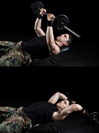 over black: Bent-arm barbell pullover exercise. Studio shot over black. Stock Photo