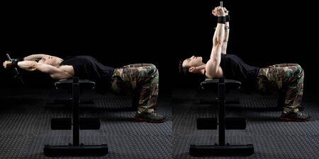 pullover: Dumbbell pull over exercise. Studio shot over black. Stock Photo