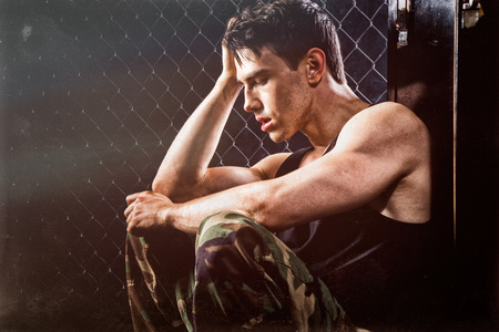working out: Athletic man recovering after working out. Stock Photo