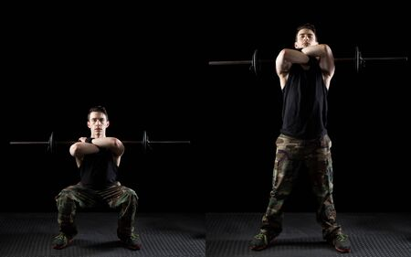 Front squat exercise. Studio shot over black.