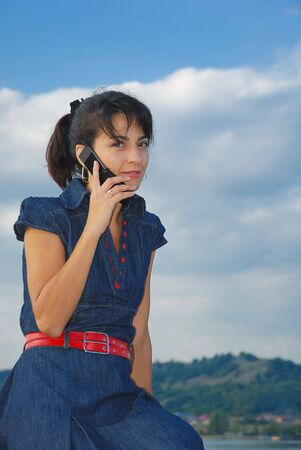 pretty young women speaking at mobile phone