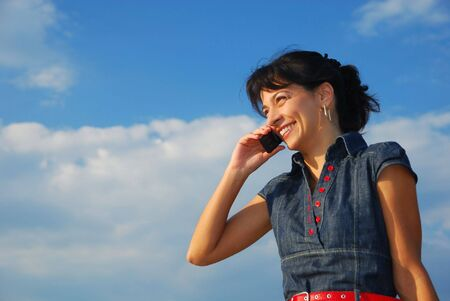 pretty young woman with cell phone, laughing Stock Photo