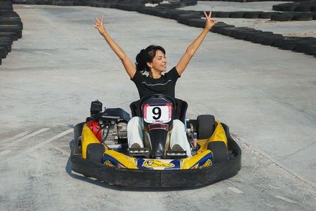 carting: happy brunette women wining the karting race