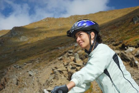 young happy woman riding safety a mountain bike photo