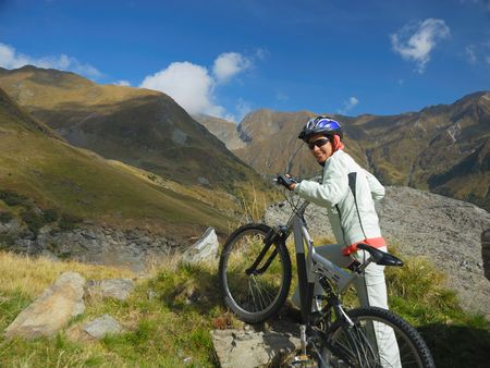 young woman on rocky mountain bike trial photo
