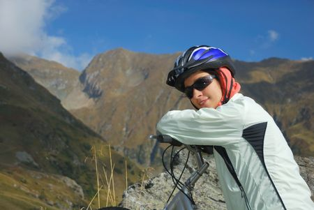 pretty biker recovering after mountain trail photo