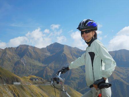 biker posing in the beautiful mountain enviroment photo