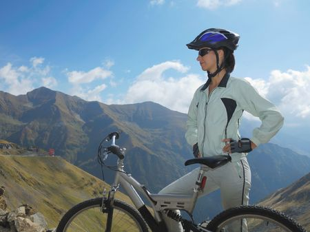 young woman and bike in the beautiful mountain landscape photo