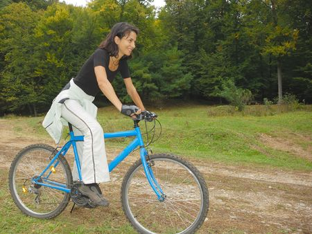 happy biker riding in autumn colorful environment Stock Photo - 5662427
