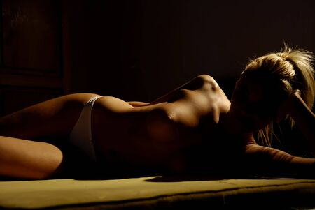 lovely shapes of a woman under directional light