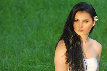 beautiful young lady with long black hair next to copy space Stock Photo - 7290454