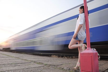 single lady on platform looking at train that is vanished in light