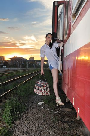 baggage train: pretty young lady leaving the town at the end of the day