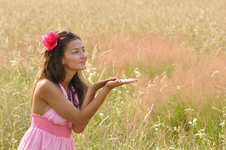 young lady gesturing giving with hands to copy space Stock Photo - 7813138