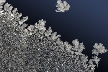 gradual: winter background frozen water crystals on gradual dark blue Stock Photo
