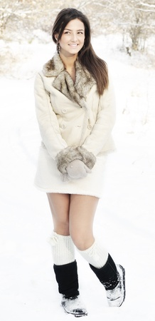 full portrait of young lady smiling looking side, outdoor winter