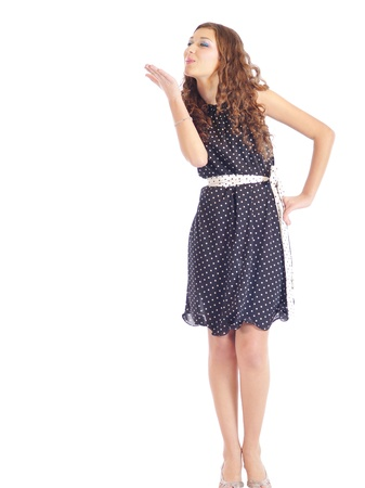 beautiful lady, wearing a retro style dress with spots, sending a lovely kiss Stock Photo