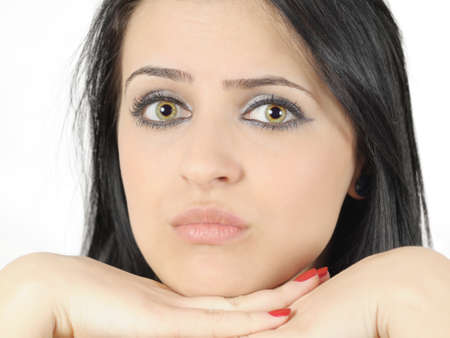 closeup head portrait of an beautiful sad young woman with chin on both hands photo