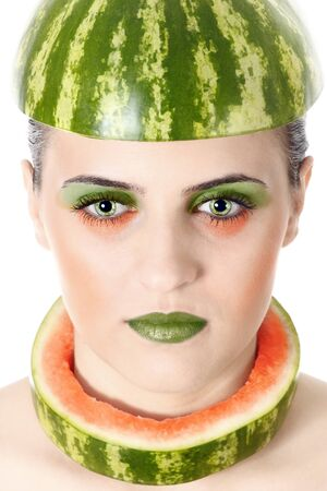closeup beauty portrait of an young woman wearing pieces of water melon