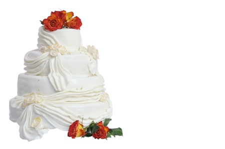 Marzipan wedding cake with natural roses isolated on white photo