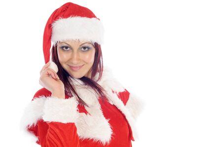 Cute smiling young woman wearing a red christmas costume. Isolated on white. Stock Photo
