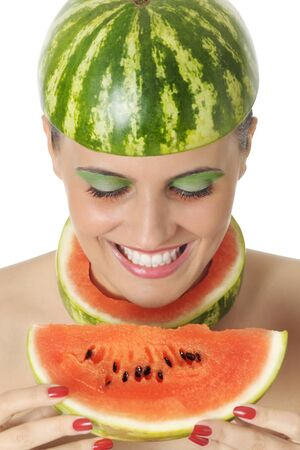 Happy young woman looking at water melon Stock Photo