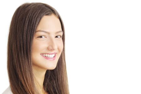 young woman smiling and looking at camera, isolated on white
