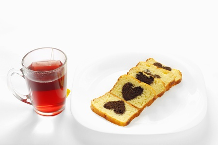 cake with cocoa heart inside and a cup of tea Stock Photo