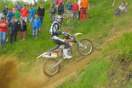 GHELARI, ROMANIA - MAY 4 2012: Norbert Levente JOZSA (on moto) in action on KTM bike, at prologue hard enduro race