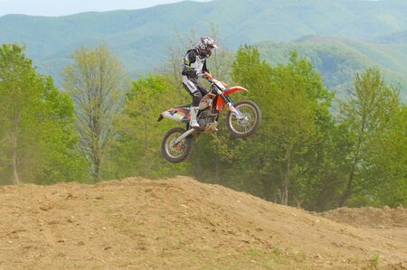 GHELARI, ROMANIA - MAY 4 2012: Norbert Levente JOZSA in action jumping with his KTM bike, at hard enduro race