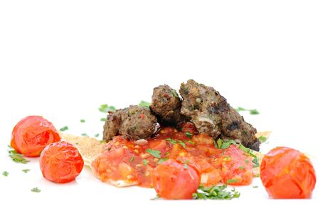 Greek traditional food with grilled red meat, spice and tomato