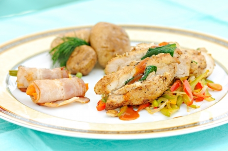 meal with prepared chicken meat and vegetables Stock Photo