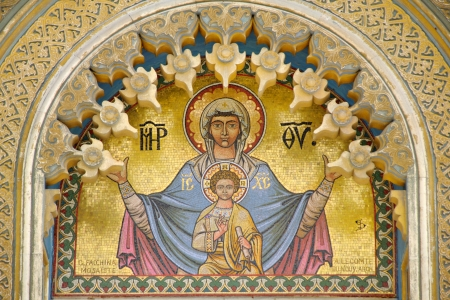 Iconic golden mosaic of Mary and child Jesus