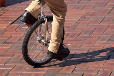 Unicycle being ridden Standard-Bild