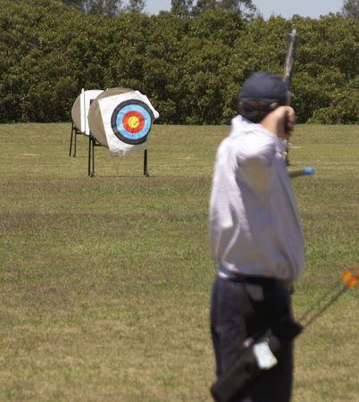 In focus target, out of focus archer Standard-Bild