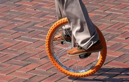 Performer on an unicycle Standard-Bild