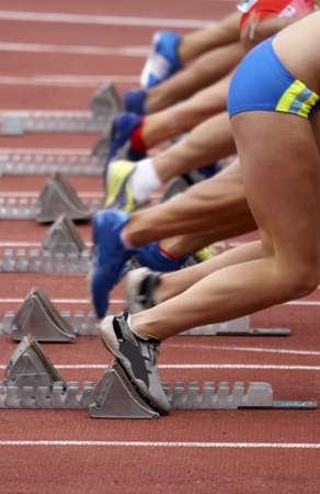 Runners starting the their race - just off the blocks Standard-Bild
