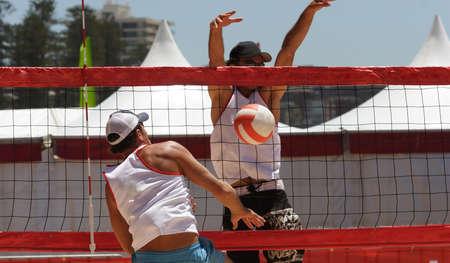 Beach volleyball players at the net Standard-Bild