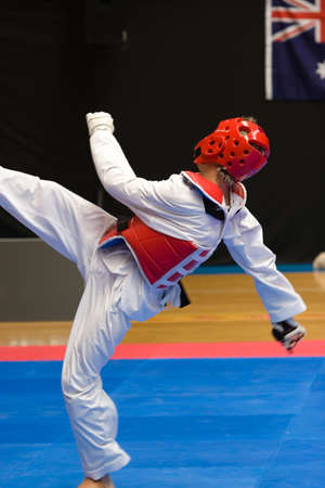 Martial arts competitor in action kicking