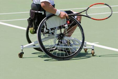 A wheelchair bound athlete on the tennis court