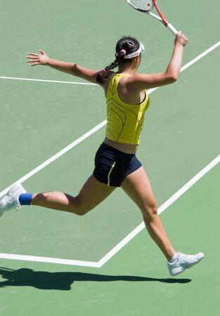 Tennis player doing a running forehand