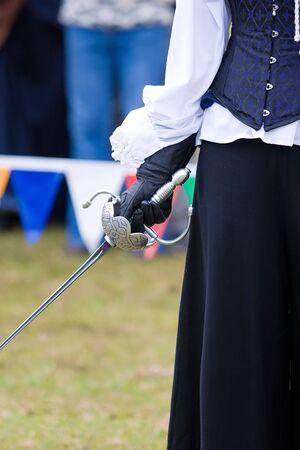 A woman holding a rapier