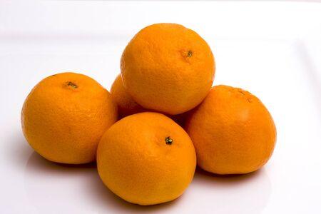 A stack of oranges on a white background Standard-Bild
